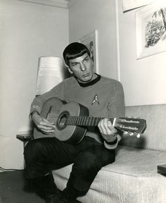 Leonard Nimoy As Spock, playing a guitar.  This picture is just all kinds of epic