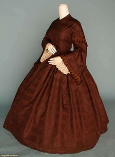 1850's Chocolate Silk Brocade, 1- piece Day Dress with capped pagoda sleeves trimmed in silk chennile & white embroidered under sleeves.