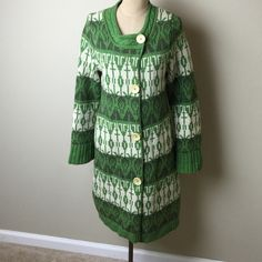 Anthropologie long length heavy lamb wool cardigan Fabulous patterned long length cardigan. Heavier weight. 2 side pockets  please note. Very small hole on front edge binding, as seen in pic #4. 100% lambs wool Anthropologie Sweaters