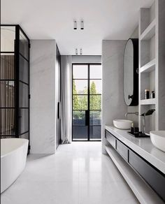 INSPIRATION: curved edges and clean lines in this chic bathroom are a winning combination with black steel framed doors | est living