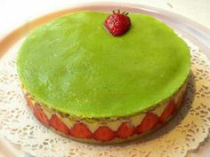 Fraisier (French strawberry cake): This classic French patisserie is a delicious assembly of 2 layers of genoa sponge filled with strawberries and crème mousseline (confectioner's custard with butter). The sponge is soaked in strawberry syrup and the cake is topped with a thin layer of marzipan.
