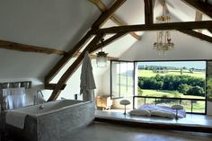 Idea for the upstairs bed and bathroom in the small barn - it could have the view up to the windmill