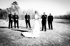Bride and Groom posing with Groomsmen on Running Deer's Golf Course | Photo by Zoha Photography