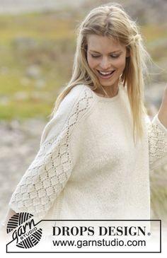 Bluse med hulmønster på skulder og ærme, strikket ovenfra og ned i DROPS Puna. Størrelse S - XXXL
