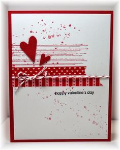 a little grunge (from SU), some washi tape, punched hearts and twine.  Colors are real red and white.