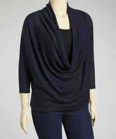Boasting a decadently draped front and on-trend dolman sleeves, this delightful top is a dazzling addition to any wardrobe. A soft rayon blend with a hint of stretch from spandex ensures this pretty piece is as comfy as it is cool. Size note: This item runs a size small. Please refer to size chart.