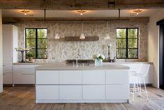 White lacquer kitchen w/ stone wall; Sue White Heinz