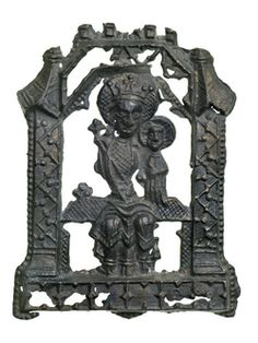 Pilgrim badge from the shrine of Our Lady of Walsingham at Walsingham Priory. It shows the seated figure of the Virgin Mary with Jesus Christ as a baby beside her. Both figures have haloes around their heads. Around the figures is a frame decorated at the sides with a zigzag and dot motif. Above their heads is a crenellated canopy.  Late 14th-early 15th century | Museum of London