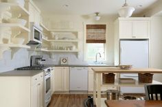 Love the white cabinets, open shelving, island...heck, I love it all.