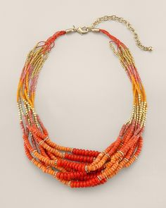 Orange and red multistrand necklace.