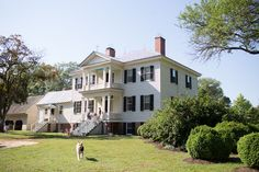 Photo Credit: Patricia Lyons. The two-story Greek Revival plantation house has two identical facades, each proudly greeting the river or road with a two-story entry.