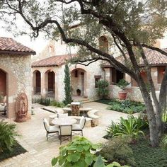 Tuscan style patio/courtyard with fountain.