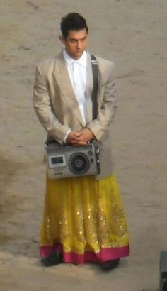 """Aamir Khan, who is shooting for Rajkumar Hirani's """"P.K."""" in Rajasthan, has used a radio bought from Chor Bazaar here for one of the sequences in the film. The 47-year-old was spotted wearing a skirt and a blazer during the film shoot and also carrying a radio in his hand."""