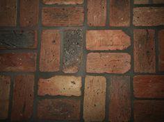 Salvated bricks, sliced into tile for floor/wall use.  Bathroom floor?