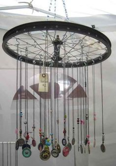 Bicycle wheel to display necklaces.