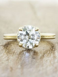 Reposa is a vintage inspired double-band halo engagement ring by Ken + Dana Design.