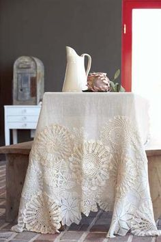 How to Make a Doily Tablecloth - Tea stain fabric, stitch doilies onto tablecloth, embellish with buttons, ribbon, embroidery, etc.