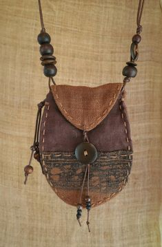 A beautifully evocative patchwork talisman pouch. Talisman pouches are normally … A beautifully evocative patchwork talisman pouch. Talisman pouches are normally worn around the neck. Textile Jewelry, Fabric Jewelry, Leather Jewelry, Leather Craft, Silver Jewellery, Silver Ring, Leather Pouch, Leather Purses, Embroidered Paper