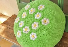 Floor knitted cushion, crochet pouf, floor pillow green with daisies. decorative ottoman. African flower pattern.. $220.00, via Etsy.