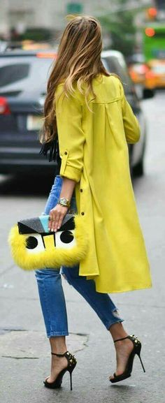 Love this color coat and matching funky bold bag!