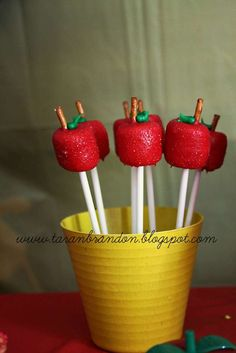 Apple marshmallow pops at a Snow White birthday party! See more party planning ideas at CatchMyParty.com!