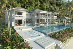 Separate pavilions of living joined together by glass and timber breeze ways and right on the beach!