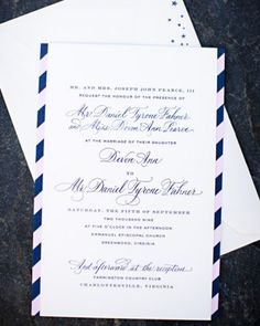 The letterpressed invitation is backed with pink-and-navy-striped card stock. The inner and outer envelopes feature stars stamped on the front, hinting at the subtle fairy-tale aspect of this couple's wedding.