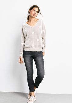 """A classic v neck design with delicate stars knitted into a lightweight yarn, this intricate jumper in neutral tones willl seamlessly update your look. •Lightweight star knit jumper. •Loose fit. Try your usual size. •V-neck with longsleeves and ribbed, collar cuff & hem. •Model is 5'9"""" and wears size S."""
