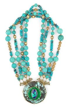 Tony Duquette (American, 1914-1999),  Symbolizes the Evolution of the Soul Through Growth Experience', 1990s. A carved turquoise, azurmalachite, glass and vermeil necklace