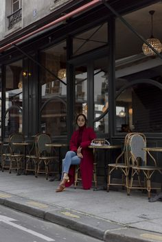 Aimee Song of the blog Song of Style wears a red monochrome outfit with Balenciaga mules in Le Marais during Paris Fashion Week