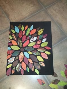 Paint canvas. Cut scrapbook paper into shapes. Lay out to find pattern you like. Elmer's glue pieces on with just a drop of glue since the modge podge will hold it all on. Fold over the pieces on the side. Let dry. Modge podge top and sides. All done!
