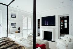 Dream bedroom - fireplace, sitting in front of bed, tv mounted on wall, all white. I want to move it.