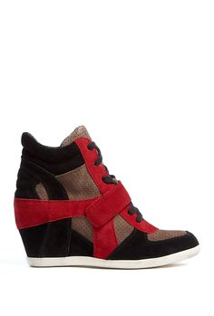 Taupe punched suede wedge heeled trainer from Ash featuring black & red suede panelling, black lace-up top, single upper Velcro strap & white rubber outsole