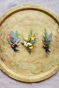 citrus boutonnieres  honey of a thousand flowers floral design by sarah winward