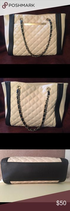 💥Aldo Gold Chain Quilted Tote Bag 💥 Beige tote 👜 with black trim & gold chain shoulder straps. Roomy interior with large middle zip compartment and 3 cell phone sized pockets. Front exterior compartment is great for holding keys & sunglasses. Brand new condition - never used! Aldo Bags Shoulder Bags
