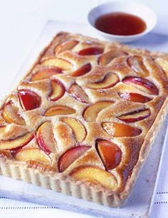hours · Vegetarian · This peach and almond tart is a little effort to make, but the results are delicious, with a light hazelnut and almond frangipane holding the poached peach slices. You can skip the pastry making part… Beaux Desserts, Just Desserts, Delicious Desserts, Dessert Recipes, Oreo Desserts, Sweet Pie, Sweet Tarts, Almond Tart Recipe, Tarts Recipe