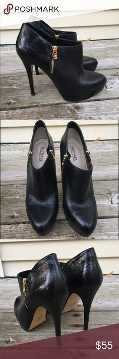 Black Micheal Kors booties These stylish ankle boots from Micheal Kors have never been worn. Made from a black leather with a snake skin detail near the heel. Women's size 9 Michael Kors Shoes Ankle Boots & Booties