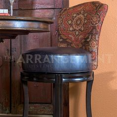 Navajo Collection Bar Stool  These bar stools are not only fun to look at, but they're comfortable to sit in, too! The fabric and leather selection here work together to weave a tale of history.