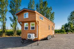 From Mint Tiny Homes is this customized 34' Loft Edition tiny house with two king size bedroom lofts and a large soaking tub in the bathroom.