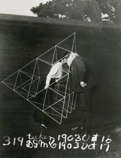 Alexander Graham Bell and Mabel kissing within a tetrahedral kite, October 1903.