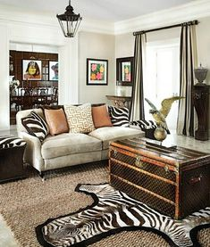 Go on a safari in your own home by decorating the living room with a piece of colonial mahagony furniture, a battered trunk and animal prints in black/white/brown/tan