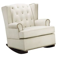 •Comfortable, chic and neutral twist on classic wingback chair with luxurious nailhead detail  • Soft upholstery with padded arms, tufted fabric with removable cushions • Wood composite frame with hardwood construction  • Dimensions 38.25 H x 31.25 W x 39 D • Includes assembly tools   This essential rocking chair could be the crown jewel of your nursery furniture and decor. The Tufted Nailhead Wingback Rocker is an upholstered nursery rocker with so much comfort and s...