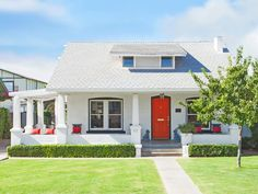 We love this bungalow with its bright red door in Phoenix, AZ #curbappeal #hgtvmagazine http://www.hgtv.com/design/outdoor-design/landscaping-and-hardscaping/copy-the-curb-appeal-phoenix-az-pictures?soc=pinterest