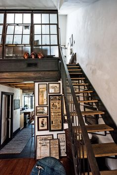 "A custom-made staircase leads to Adam Woodward's office loft, closed off from the living room with a '20s industrial window salvaged from an upstate factory. ""In His Basement, the Bowery"" NYT (study)"