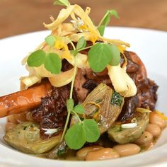 Braised Lamb Shank with Baby Artichokes Butter Beans Preserved Meyer ...