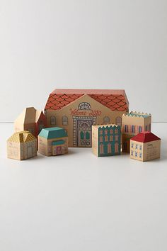 "cardboard houses.   Could use for advent calendar ""wrapping"". House numbers = days."