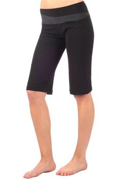 The Surya Knickers Yoga Capri in Black by Anjali. This perfect little pant is made from our Cotton, Polyester and Spandex Jersey. This balanced combination gives the fabric the comfort and feel of cotton while adding the performance functionality of Polyester. The color blocked detail on the waist band adds a little whimsy, making this the perfect pant for practice or just to stroll about town. $53.95 at www.karmic-fit.com #yoga #yogacapris