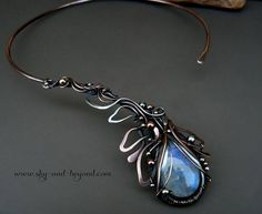 Flower Bloom - Fine Silver and Copper Necklace with Moonstone This beautiful necklace is made from copper and fine silver wire, adorned with natural Moonstone, oxidized for an antique look and carefully polished.  This collar necklace caresses the neck creating a choker look. The necklace fits the form of the neck and no attachment is required.