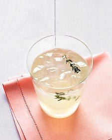 In a medium saucepan, bring sugar, thyme, and 1 cup water to a boil; stir until sugar is dissolved, about 2 minutes. Stir in lemon juice, gin (if using), and 6 cups cold water; strain into a large pitcher. Refrigerate until cold, at least 1 hour (and up to 1 week). Serve over ice, garnished with thyme sprigs, if desired.