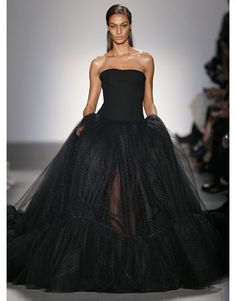 Giambattista Valli Fall 2011  For evening, or rather the red carpet, the offerings included floor-length gowns, the cake toppers being a pair of finely-dotted tulle ballgowns done in hot red and then black.